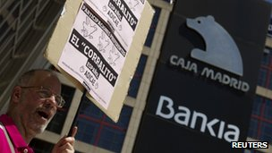 A man shouts slogans during a protest outside headquarters of Spain's fourth largest bank Bankia in Madrid May 24, 2012.