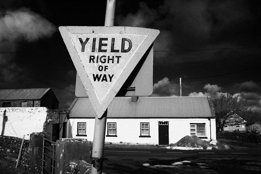 1-old-irish-red-triangle-yield-right-of-way-sign-in-rural-ireland-joe-fox.jpg